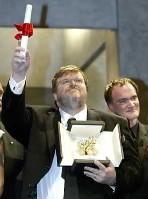 Michel Moore met Gouden Palm